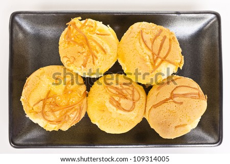 Delicious fresh muffins with cheese on plate