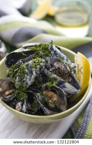 Delicious fresh mussels with beacon and cream