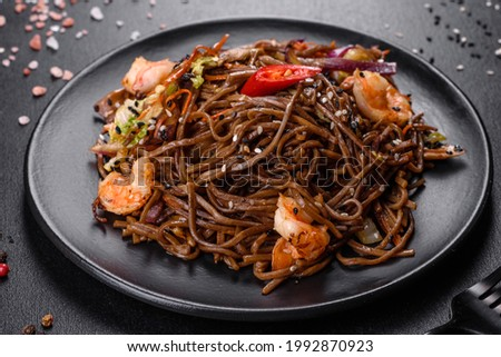 Delicious fresh pasta with tomatoes, shrimp and spices. Italian cuisine