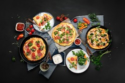 Delicious fresh pizzas variety with different souces and vegetables. Homemade food concept. Top view