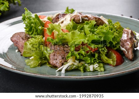 Delicious fresh salad with beef, cheese, tomatoes and lettuce leaves. Healthy food