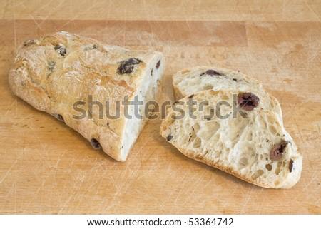 Delicious fresh sliced olive bread on cutting board