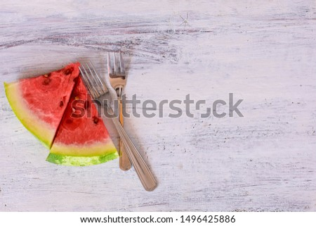 Delicious fresh Slices of watermelon at light wooden background/ Summer freshness  #1496425886