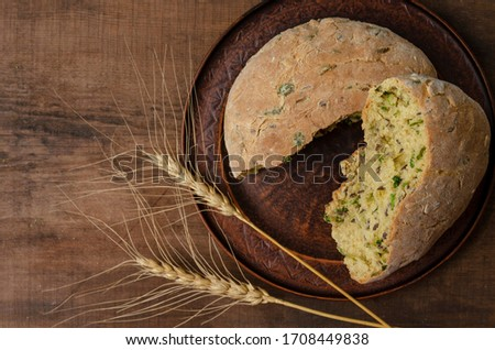Delicious freshly baked Australian Damper Loaf with onion and linen seeds on wooden background Stockfoto ©