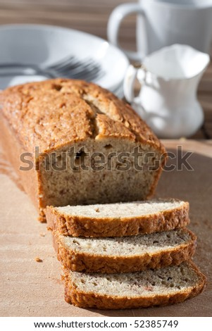 Delicious freshly baked banana bread on wooden board