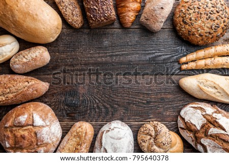 Delicious freshly baked bread on wooden background #795640378