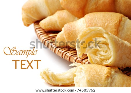 Delicious freshly baked crescent rolls on white background with copy space.  Macro with shallow dof.