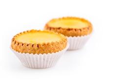 Delicious freshly baked egg tarts on white background