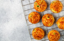 Delicious freshly baked homemade  Savory muffins with Parmesan cheese, sausage or ham and green peas for Breakfast. Selective focus, top view and copy space