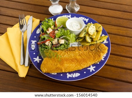 Delicious fried crumbed fish with kipfler potatoes and a fresh garden salad.