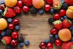 Delicious fruits on wooden background.