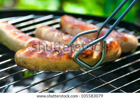 Delicious german sausages or bratwurst on barbecue grill