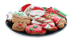 Delicious gingerbread Christmas cookies on white background
