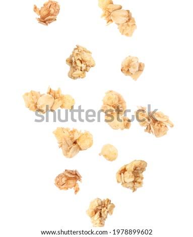 Delicious granola falling on white background. Healthy snack   Stock photo ©