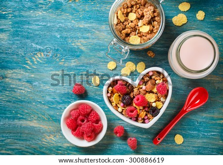 Shutterstock Delicious granola with berries. Healthy breakfast. View from above