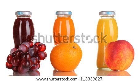 Delicious grapes, orange and apple juice in glass bottle and fruit next to it isolated on white