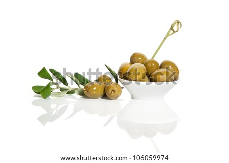 Delicious green olives with fresh branch isolated on white background. Culinary tapas eating.