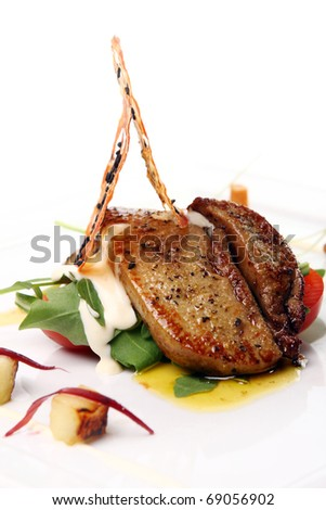 Delicious Grilled meat with vegetables and cream sauce