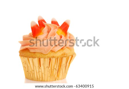 Delicious Halloween cupcake with butter cream frosting and candy corn