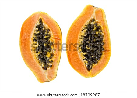 delicious halved papaya fruit isolated on white background