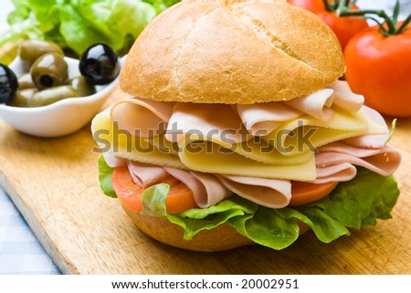 Delicious ham, cheese and salad sandwich with olives