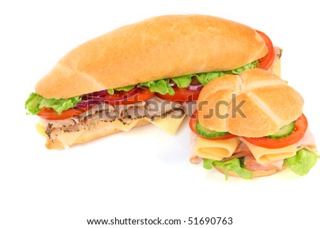 Delicious ham, cheese and salad sandwiches on white - stock photo