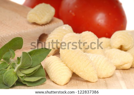 Delicious hand made Gnocchi using a Gnocchi board with tomatoes and herbs