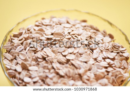 Delicious healthy breakfast. Cup of oatmeal. Yellow background. #1030971868