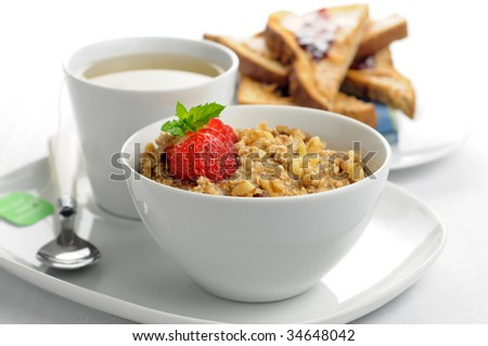 Delicious healthy oatmeal with a cup of tea and toast.