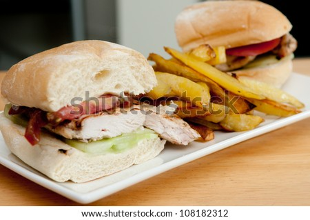 delicious heirloom tomatoes and chicken with mayo, irish cheddar cheese and hand cut home fries, plus sliced cucumber on a portuguese roll