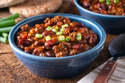 Delicious homemade beef chili con carne with green onion garnish.