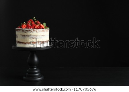 Delicious homemade cake with fresh berries and space for text on black background
