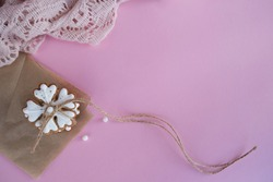 Delicious homemade Christmas cookies in the shape of a snowflake on a pink background.