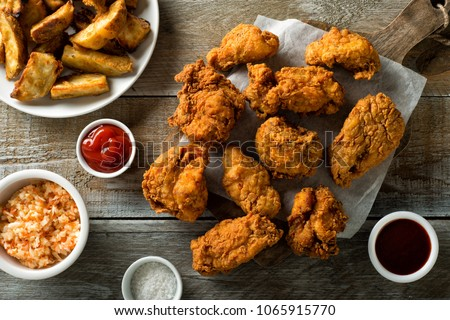Delicious homemade crispy fried chicken with taters and coleslaw. #1065915770