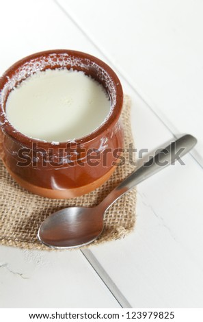 Delicious homemade curd in clay pot made from goat milk