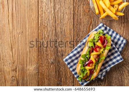 Delicious homemade hot dogs. Served with chips. Top view. #648655693