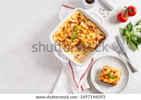 Delicious Homemade Italian Lasagna with bolognese and bachamel Sauce on white Background. Hot Tasty Lasagna with Parmesan Cheese. Restaurant menu, recipe. Top view, copy space for text
