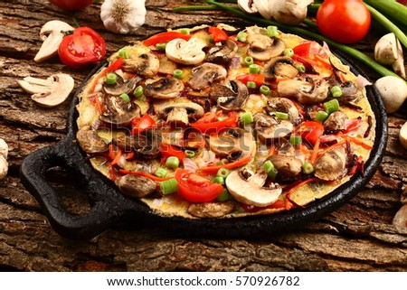 Delicious homemade mushroom omelet with herbs and spices.
