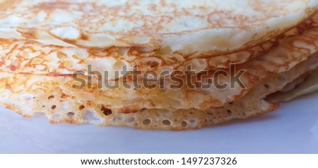 delicious homemade palatschinken close up on white plate - delicous homemade palacsinta on white background - A thin crêpe-like variety of pancakes common in Central and Eastern Europe Stock fotó ©