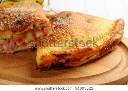Delicious homemade panzarotti filled with cheese, ham and pineapple. - stock photo