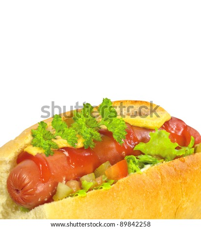 Delicious hot dog with mustard, ketchup and lettuce over white background