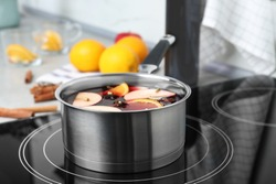 Delicious hot mulled wine in pot on stove