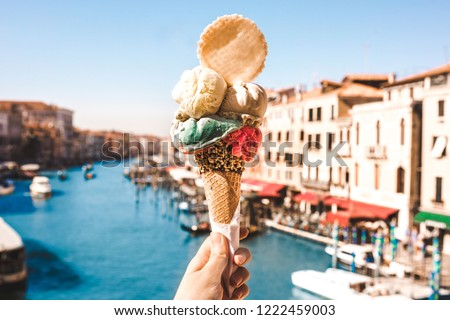 Delicious icecream in beautiful Venezia, Italy in front of a canal and historic buildings Foto d'archivio ©