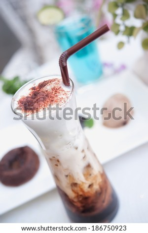 delicious iced coffee with foam  on the table