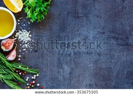 Delicious ingredients and seasoning for healthy vegetarian cooking on dark vintage background. Diet or vegan food concept. Top view. Copy space.