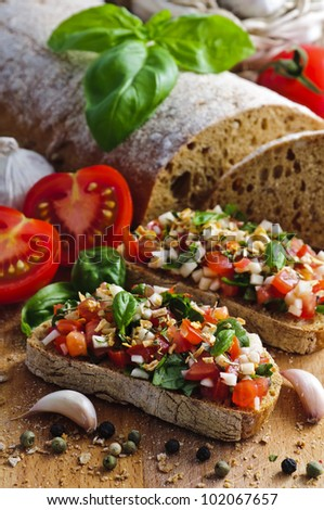 delicious italian bruschetta with tomatoes, basil and garlic