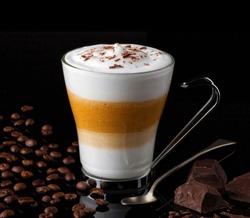 Delicious latte macchiato coffee in a glass cup