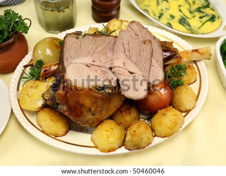 Delicious leg of lamb carved with vegetables ready to serve.