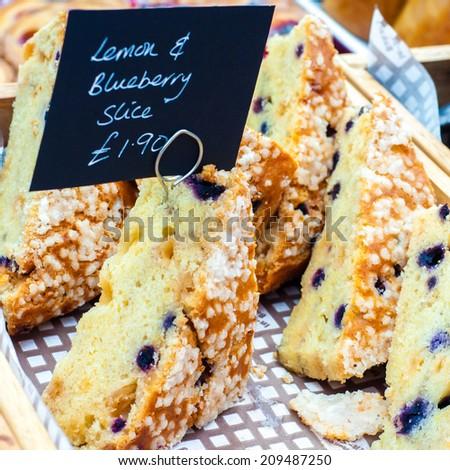Delicious lemon and raspberry cake slices in British market