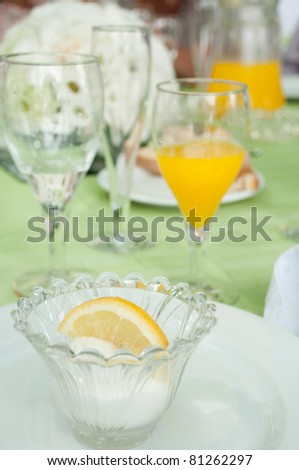 delicious lemon ice cream on a wedding table setting (it is served after the first dish in order to not mix taste between fish and meat plates)